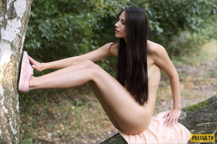 Fantastic tiny brunette Milena D stuffs a flower in her tight pussy.